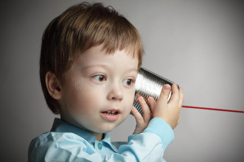 Download Boy Listen Tin Can Telephone Stock Image - Image: 29971063