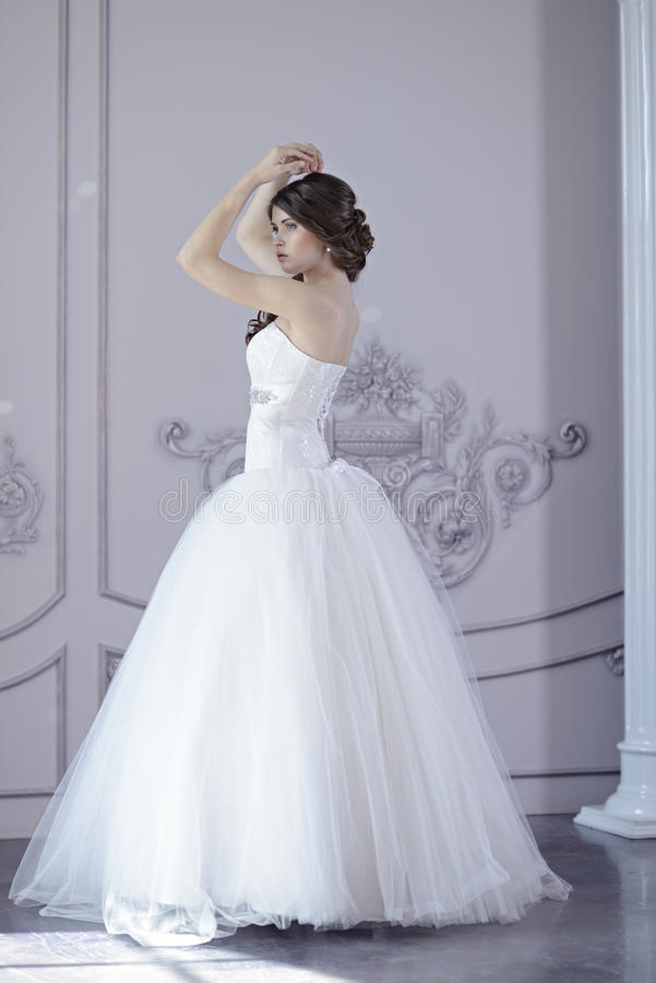 Beauty Bride In Bridal Gown Indoors Stock Photo - Image: 69897734