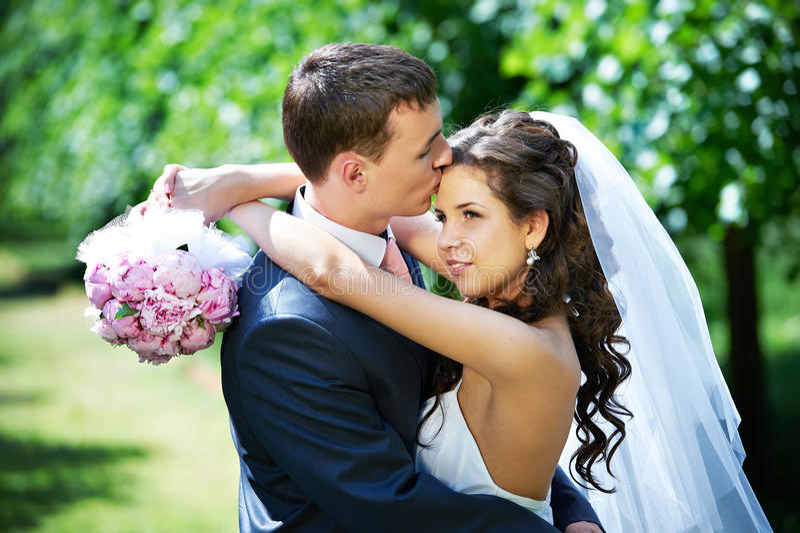 Beauty bride and groom on wedding walk royalty free stock image