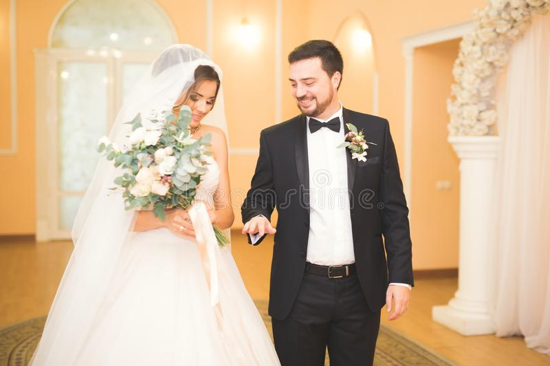 Beauty bride and handsome groom are wearing rings each other. Wedding couple on the marriage ceremony. Beauty bride and handsome groom are wearing rings each stock photos