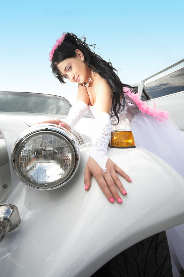 Beauty bride with limousine royalty free stock images