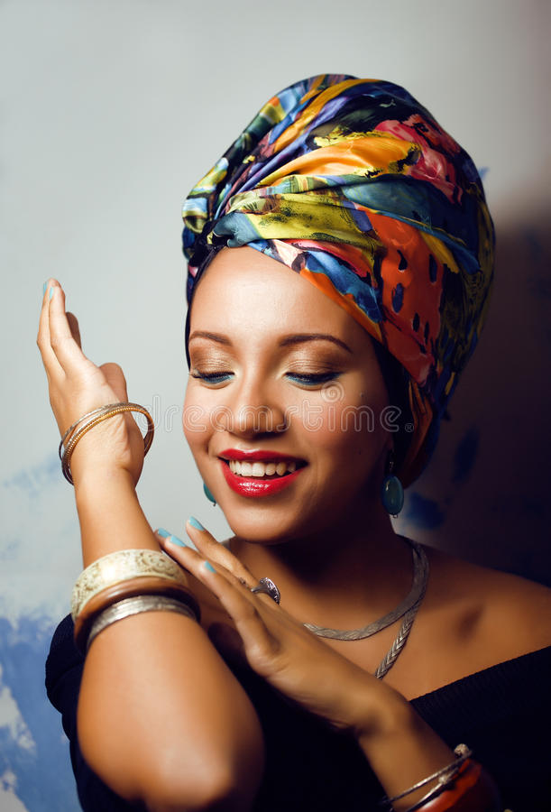 Beauty bright african woman with creative make up, shawl on head like cubian closeup smiling royalty free stock photo