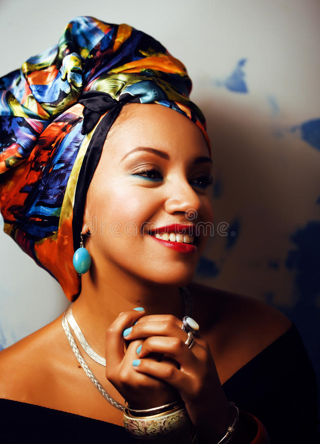 Beauty bright african woman with creative make up, shawl on head. Beauty bright real african woman with creative make up, shawl on head like cubian closeup stock photography