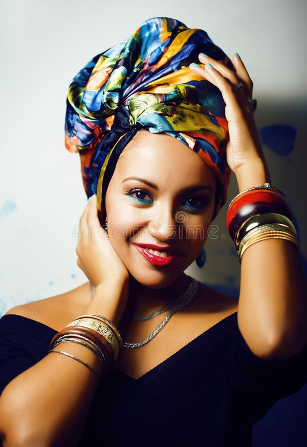 Beauty bright african woman with creative make up, shawl on head like cubian closeup smiling stock photography