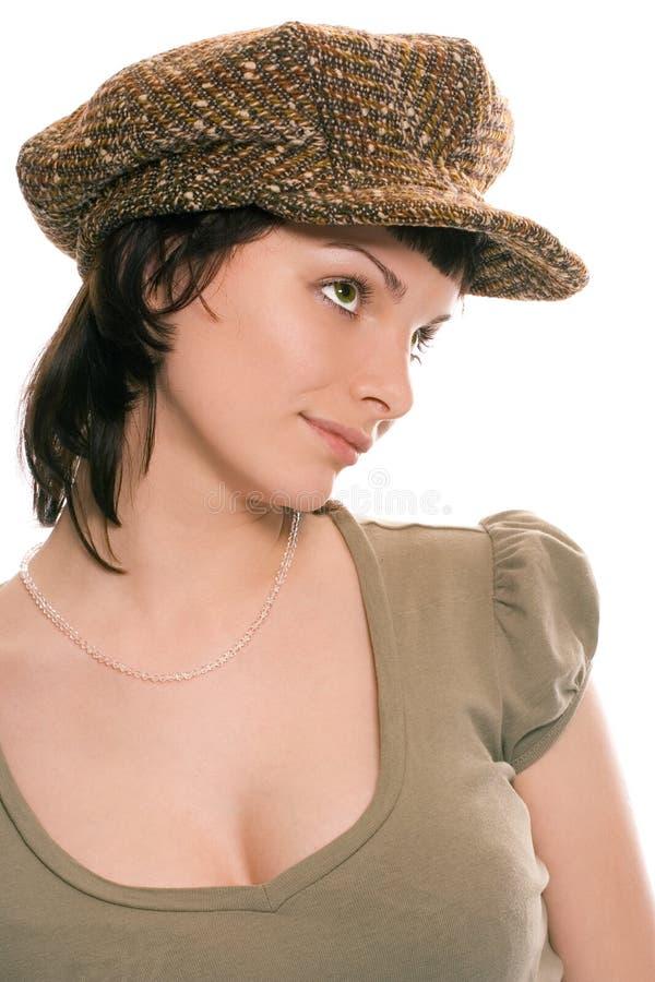 Beauty brunette girl in cap stock image