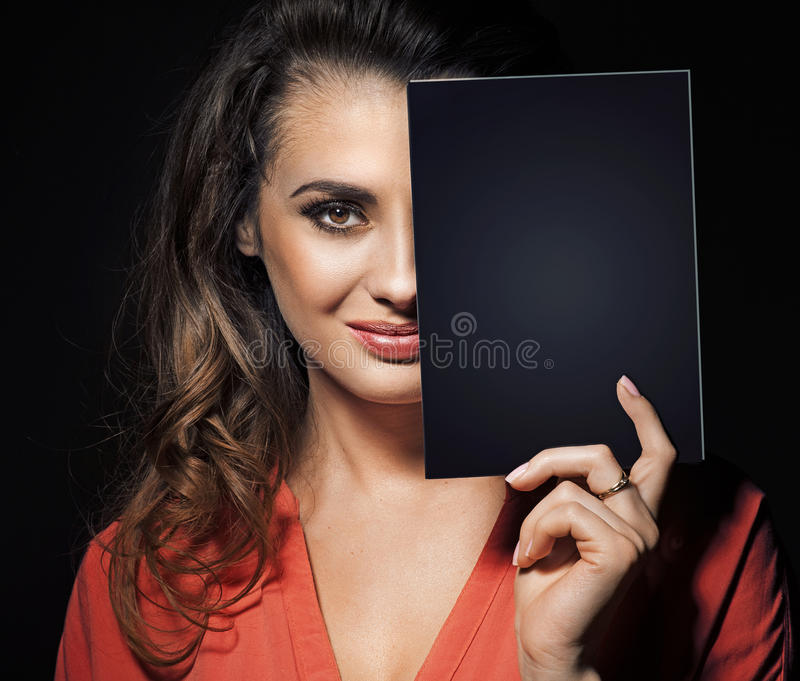 Download Beauty Brunette Hiding Half Of Face Behind Black Panel Stock Photo - Image: 30139928