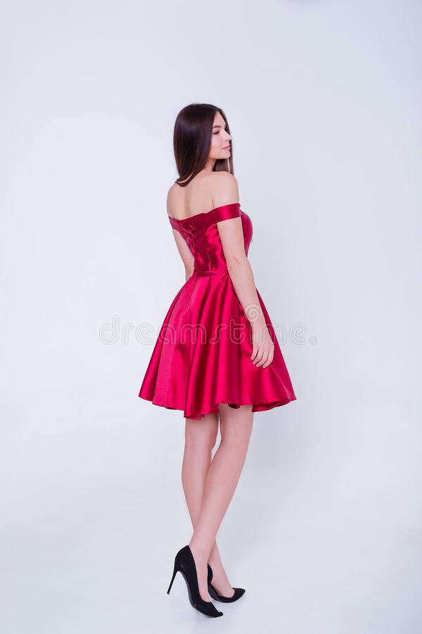 Beauty brunette model woman in cocktail dress. Beautiful fashion luxury makeup and hairstyle. Seductive girl silhouette royalty free stock photos