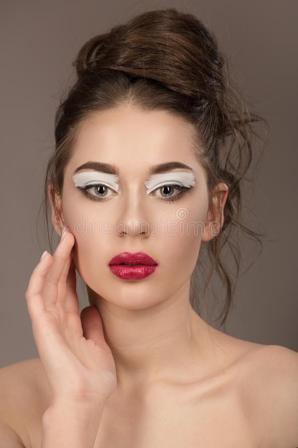 Beauty brunette woman with perfect makeup. Beautiful professional holiday makeup stock photo