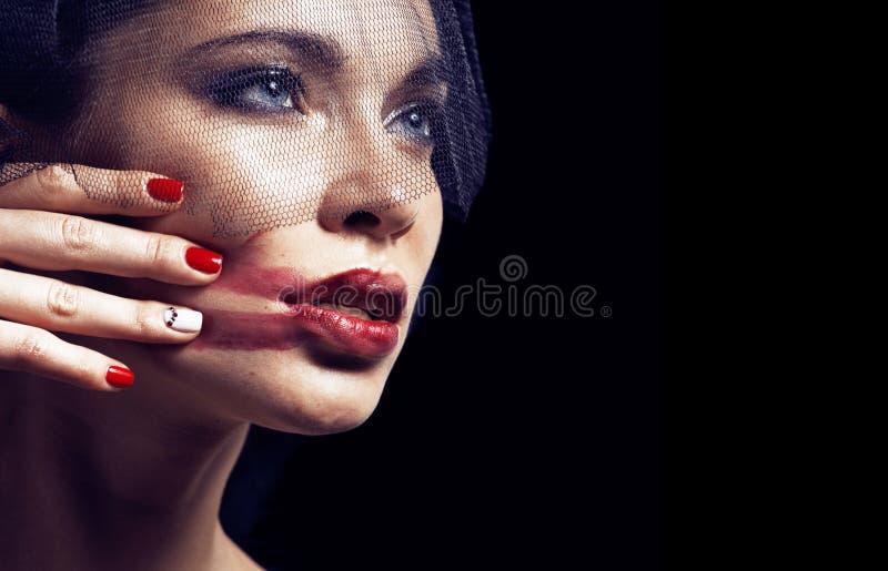 Beauty brunette woman under black veil with red manicure close u. P, grieving widow, halloween makeup luxury concept stock photo