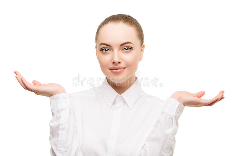 Beauty bussines woman portrait. Proposing a product. Beautiful g. Irl showing empty copy space on the open hand palm for text. Gestures for advertisement stock photography