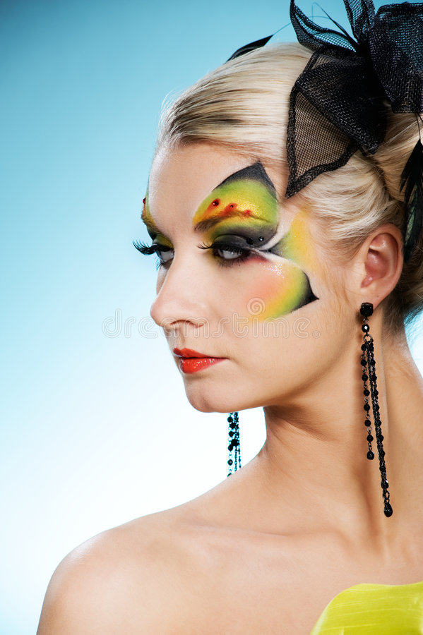 Beauty with butterfly face-art. Young beauty with butterfly face-art royalty free stock photo