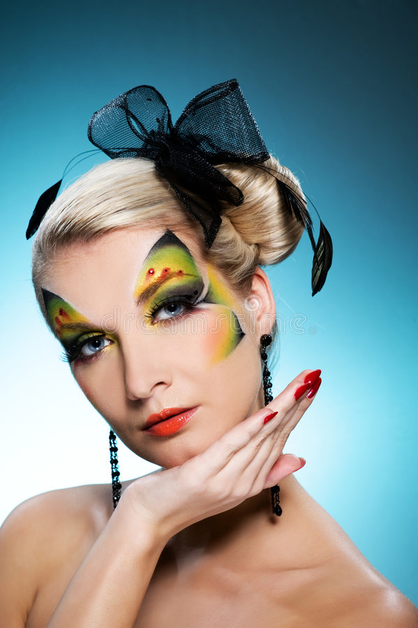 Beauty with butterfly face-art. Young beauty with butterfly face-art stock image