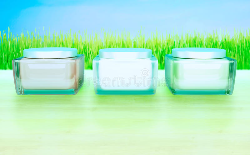 Daily, beauty care cosmetic. Face creams. Skin care. Three Flasks with cosmetic cream on a blue background. Daily, beauty care cosmetic. Face creams. Skin care royalty free stock photo