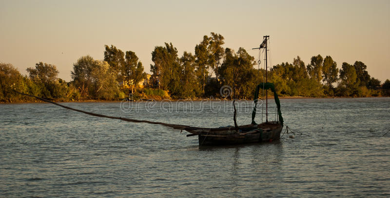The typical `Barcaza` ancient Guadalquivir transport or fishing boat in Coria Del Rio, Seville, Spain. The beauty of the city of Sevle, Spain, in the region of royalty free stock photos