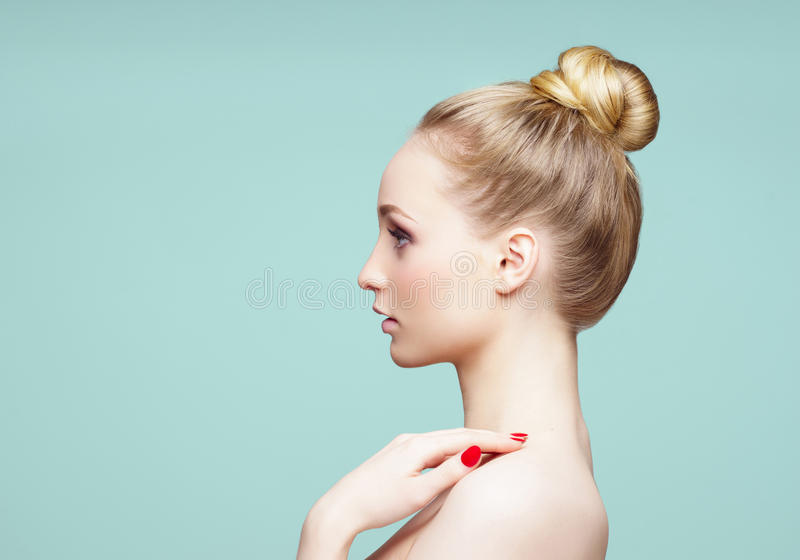 Beauty close-up portrait of beautiful, fresh and healthy girl over cyan background. stock images