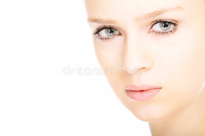 Beauty close-up portrait young woman face. On white background royalty free stock image