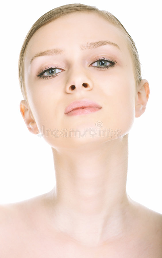 Beauty close-up portrait young woman face. On white background royalty free stock photography