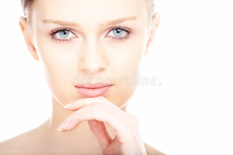 Beauty close-up portrait young woman face. On white background stock photos