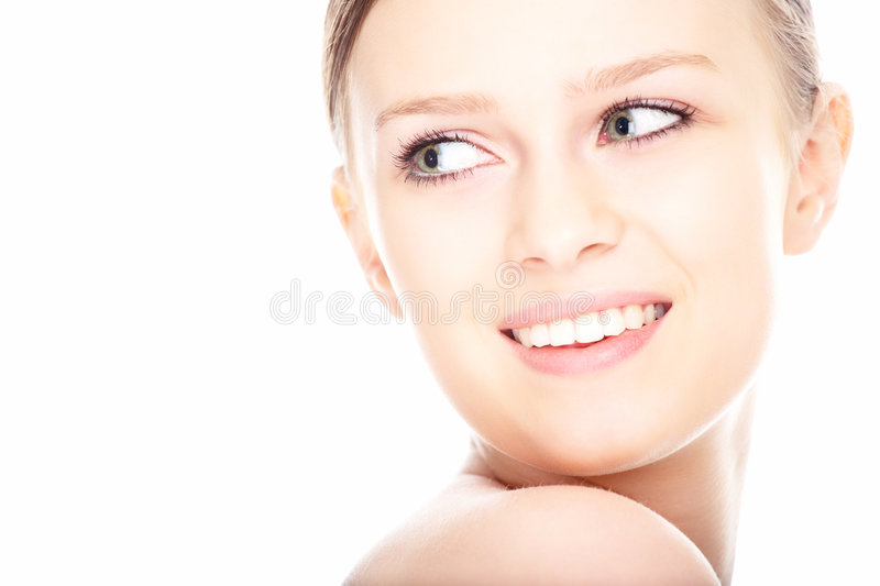 Beauty close-up portrait young woman face. On white background royalty free stock photo