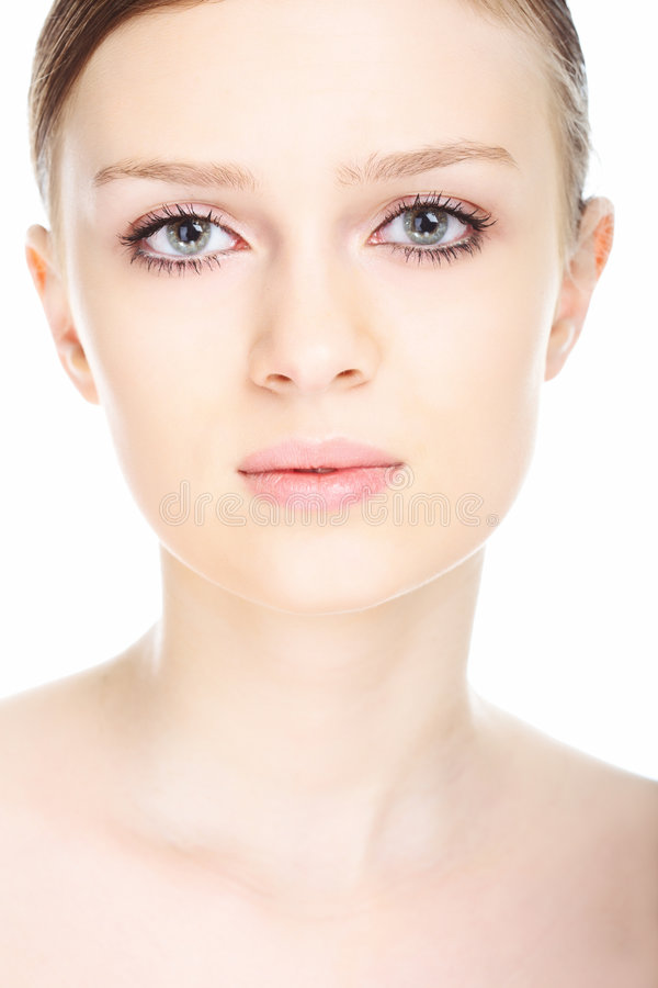Beauty close-up portrait young woman face. On white background stock photo