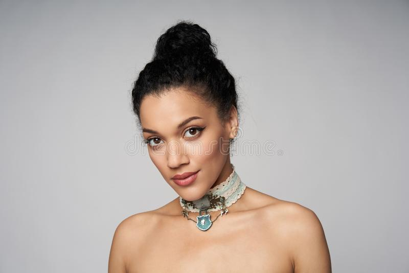 Beauty portrait of beautiful mixed race woman wearing chocker royalty free stock photos