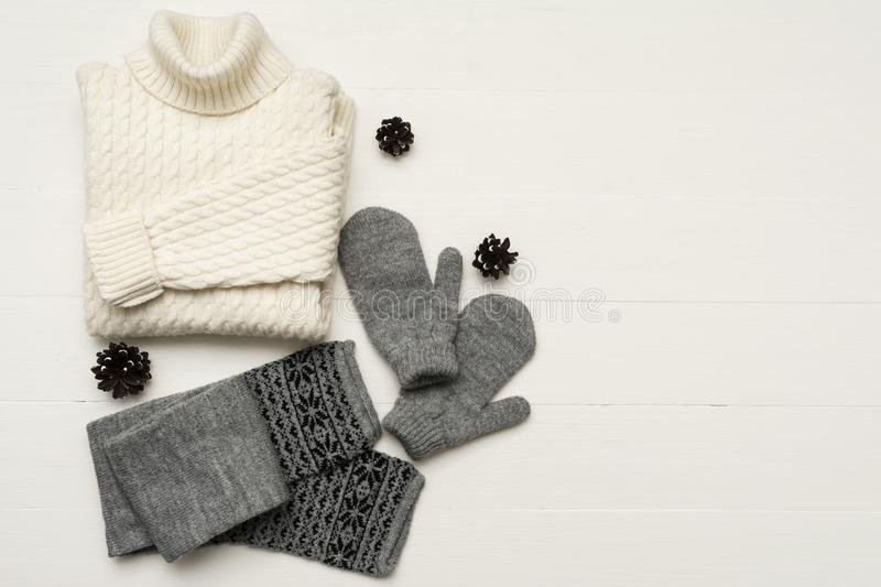 Beauty clothes arrangement with , mittens, sweater, scarf. flat lay, top view royalty free stock photo