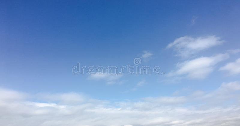 Beauty cloud against a blue sky background. Clouds sky. Blue sky with cloudy weather, nature cloud. White clouds, blue sky and sun. Beauty cloud against a blue stock photos