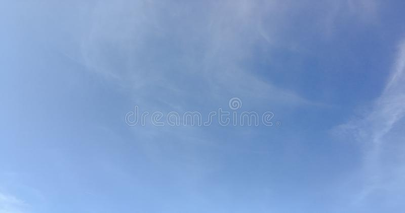 Beauty cloud against a blue sky background. Clouds sky. Blue sky with cloudy weather, nature cloud. White clouds, blue sky and sun. Beauty cloud against a blue royalty free stock photos