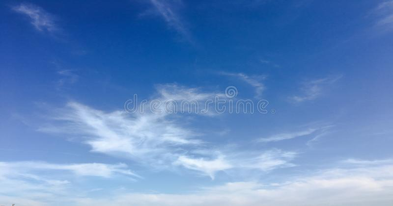 Beauty cloud against a blue sky background. Clouds sky. Blue sky with cloudy weather, nature cloud. White clouds, blue sky and sun. Beauty cloud against a blue stock photo