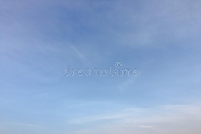Beauty cloud against a blue sky background. Clouds sky. Blue sky with cloudy weather, nature cloud. White clouds, blue sky and sun. Beauty cloud against a blue stock images