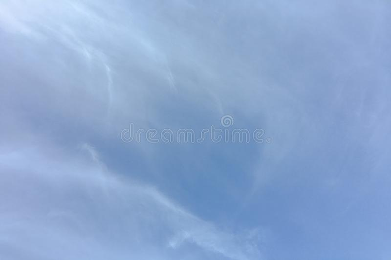 Beauty cloud against a blue sky background. Clouds sky. Blue sky with cloudy weather, nature cloud. White clouds, blue sky and sun. Beauty cloud against a blue royalty free stock photo