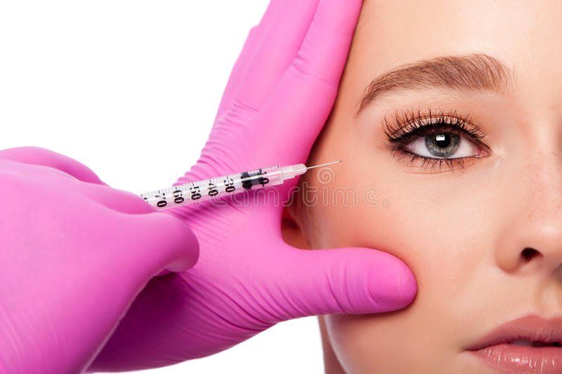 Beauty collagen filler injection in crows feet at eye royalty free stock images
