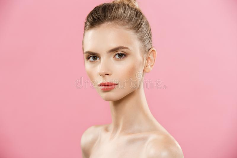 Beauty Concept - Beautiful Woman with Clean Fresh Skin close up on pink studio. Skin care face. Cosmetology. royalty free stock images