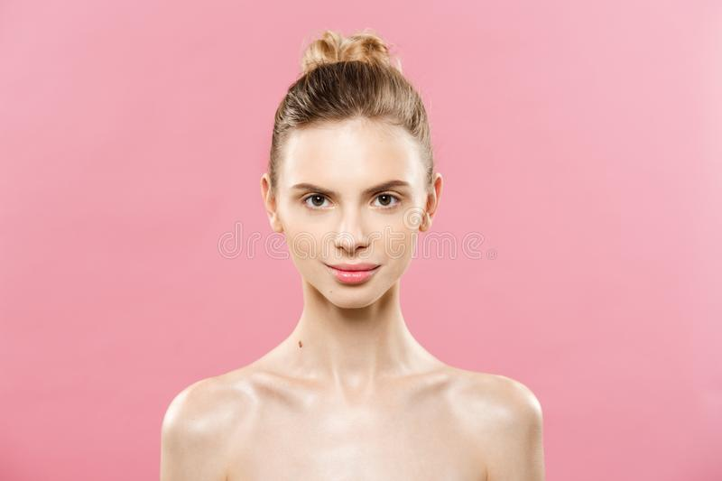 Beauty Concept - Beautiful Woman with Clean Fresh Skin close up on pink studio. Skin care face. Cosmetology. stock photo