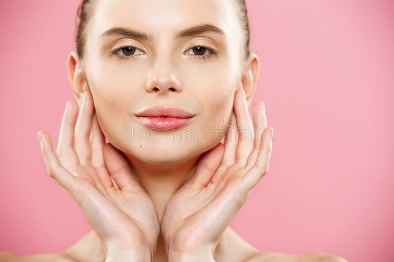 Beauty Concept - Beautiful Woman with Clean Fresh Skin close up on pink studio. Skin care face. Cosmetology. stock photography