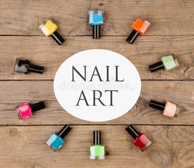 Beauty concept - Bright colorful bottles with gel-varnish for covering nails and text nail art royalty free stock image