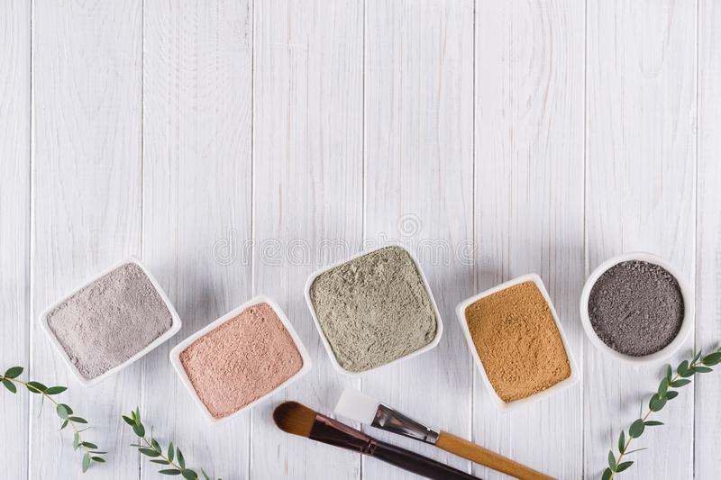Flat lay, Different clay mud powders natural ingredients for homemade facial and body mask or scrub royalty free stock photos