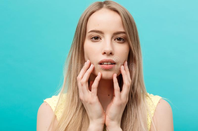 Beauty Concept: Portrait of beauty model with natural nude make up and touching her face. Spa, skincare and wellness royalty free stock photos
