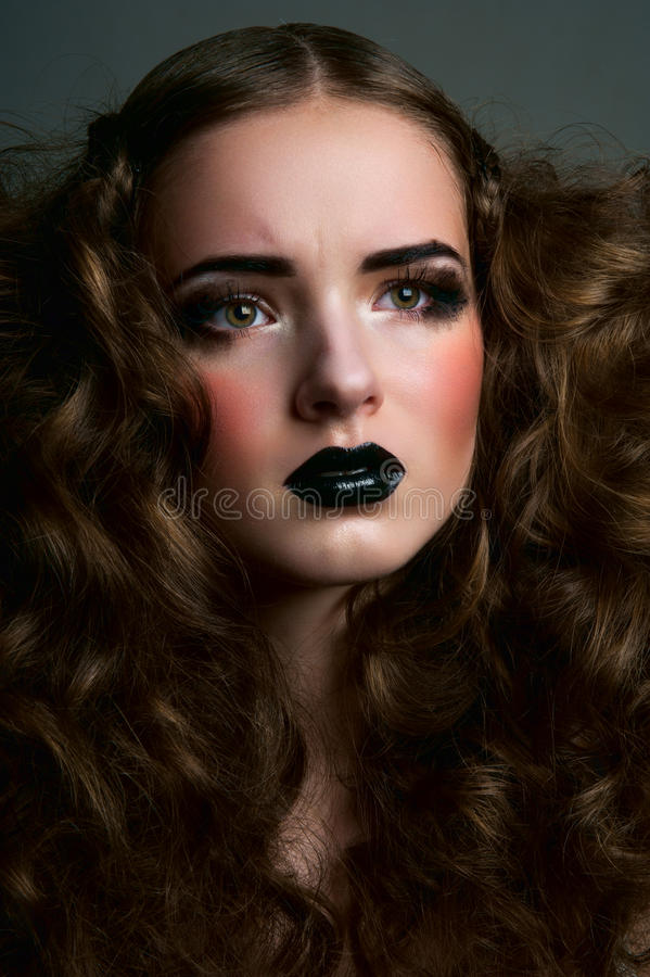 Beauty concerned girl with curls royalty free stock photos