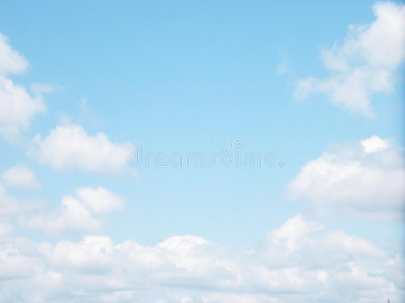 Bright blue sky with soft clouds royalty free stock photography