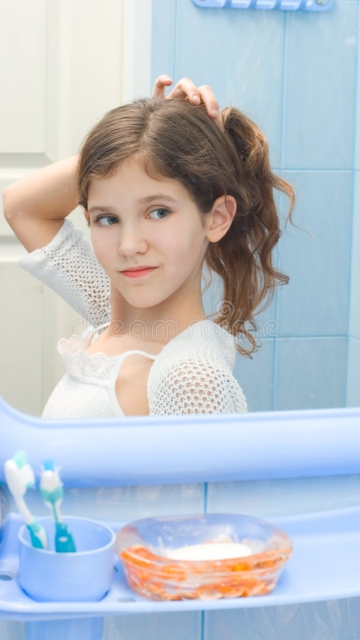 Download Beauty Conscious stock photo. Image of teen, check, brush - 9073050