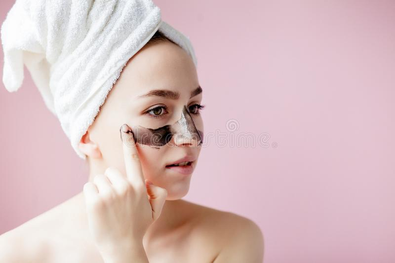 Beauty Cosmetic Peeling. Closeup Beautiful Young Female With Black Peel Off Mask On Skin. Closeup Of Attractive Woman With stock photos