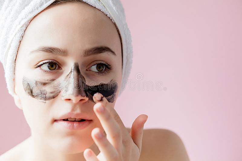Beauty Cosmetic Peeling. Closeup Beautiful Young Female With Black Peel Off Mask On Skin. Closeup Of Attractive Woman With. Cosmetic Skin Care Peeling Product stock image