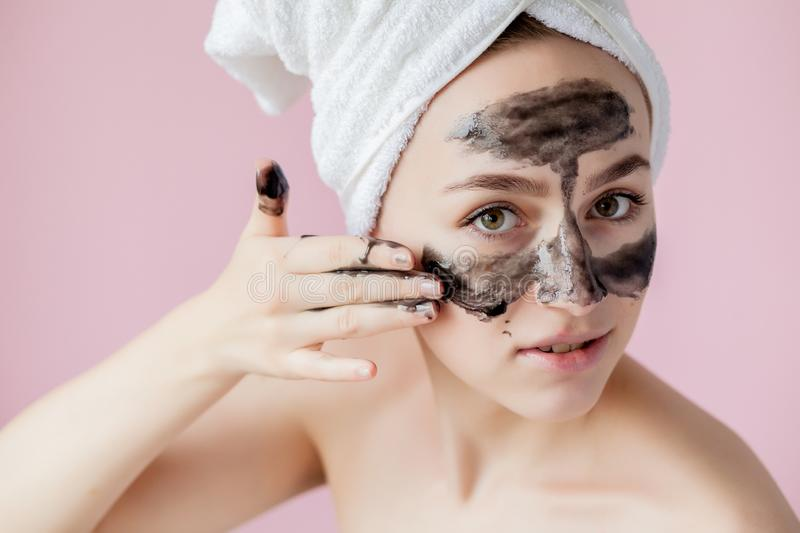Beauty Cosmetic Peeling. Closeup Beautiful Young Female With Black Peel Off Mask On Skin. Closeup Of Attractive Woman With. Cosmetic Skin Care Peeling Product stock photos