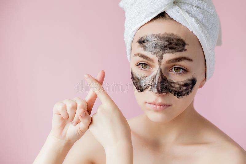 Beauty Cosmetic Peeling. Closeup Beautiful Young Female With Black Peel Off Mask On Skin. Closeup Of Attractive Woman With. Cosmetic Skin Care Peeling Product stock photo