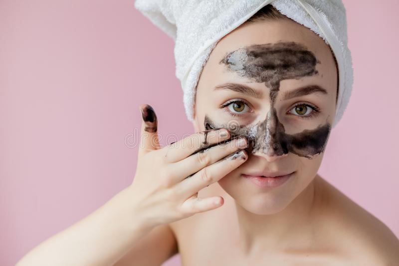 Beauty Cosmetic Peeling. Closeup Beautiful Young Female With Black Peel Off Mask On Skin. Closeup Of Attractive Woman With. Cosmetic Skin Care Peeling Product stock photography