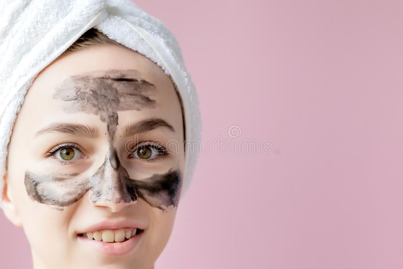 Beauty Cosmetic Peeling. Closeup Beautiful Young Female With Black Peel Off Mask On Skin. Closeup Of Attractive Woman With stock photo