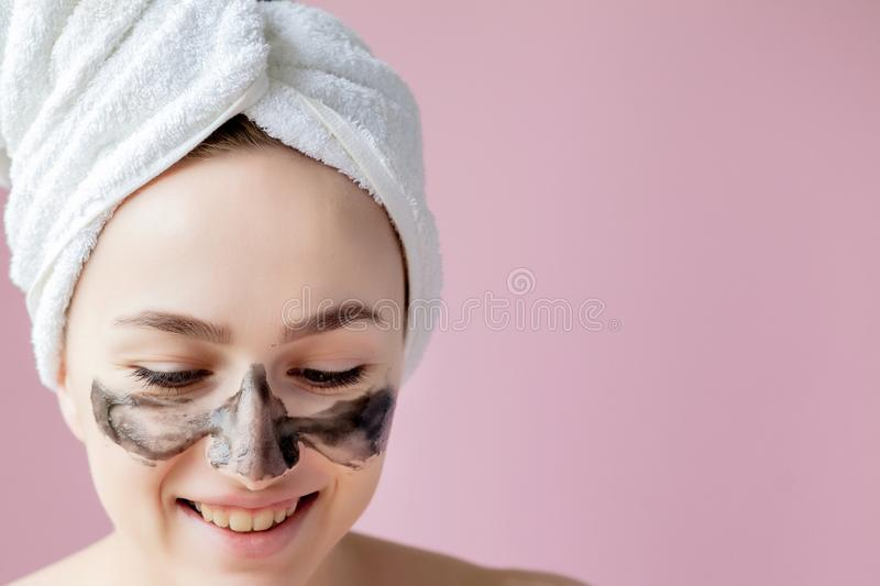 Beauty Cosmetic Peeling. Closeup Beautiful Young Female With Black Peel Off Mask On Skin. Closeup Of Attractive Woman stock photography
