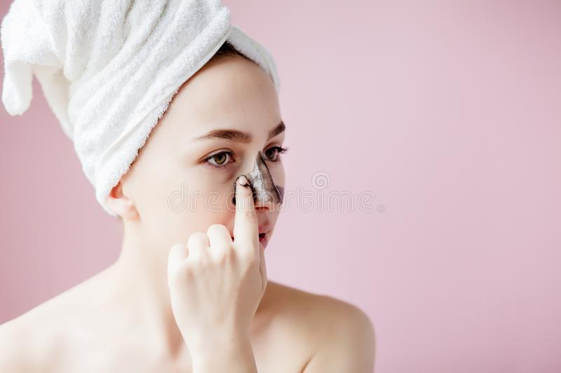 Beauty Cosmetic Peeling. Closeup Beautiful Young Female With Black Peel Off Mask On Skin. Closeup Of Attractive Woman With royalty free stock image