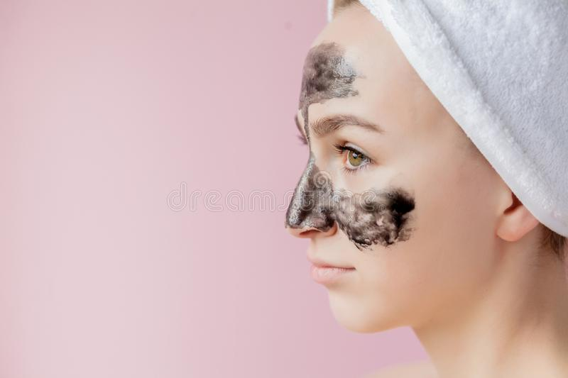 Beauty Cosmetic Peeling. Closeup Beautiful Young Female With Black Peel Off Mask On Skin. Closeup Of Attractive Woman With. Cosmetic Skin Care Peeling Product royalty free stock photo